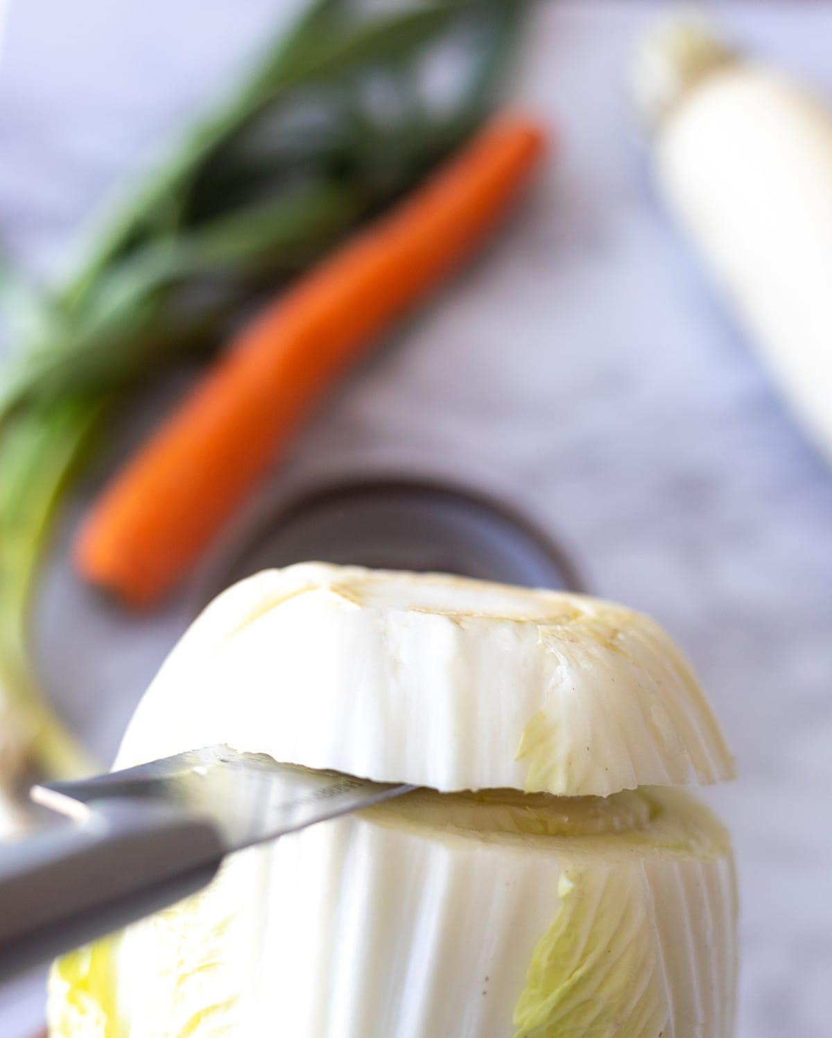 Image showing knife cutting base of napa cabbage