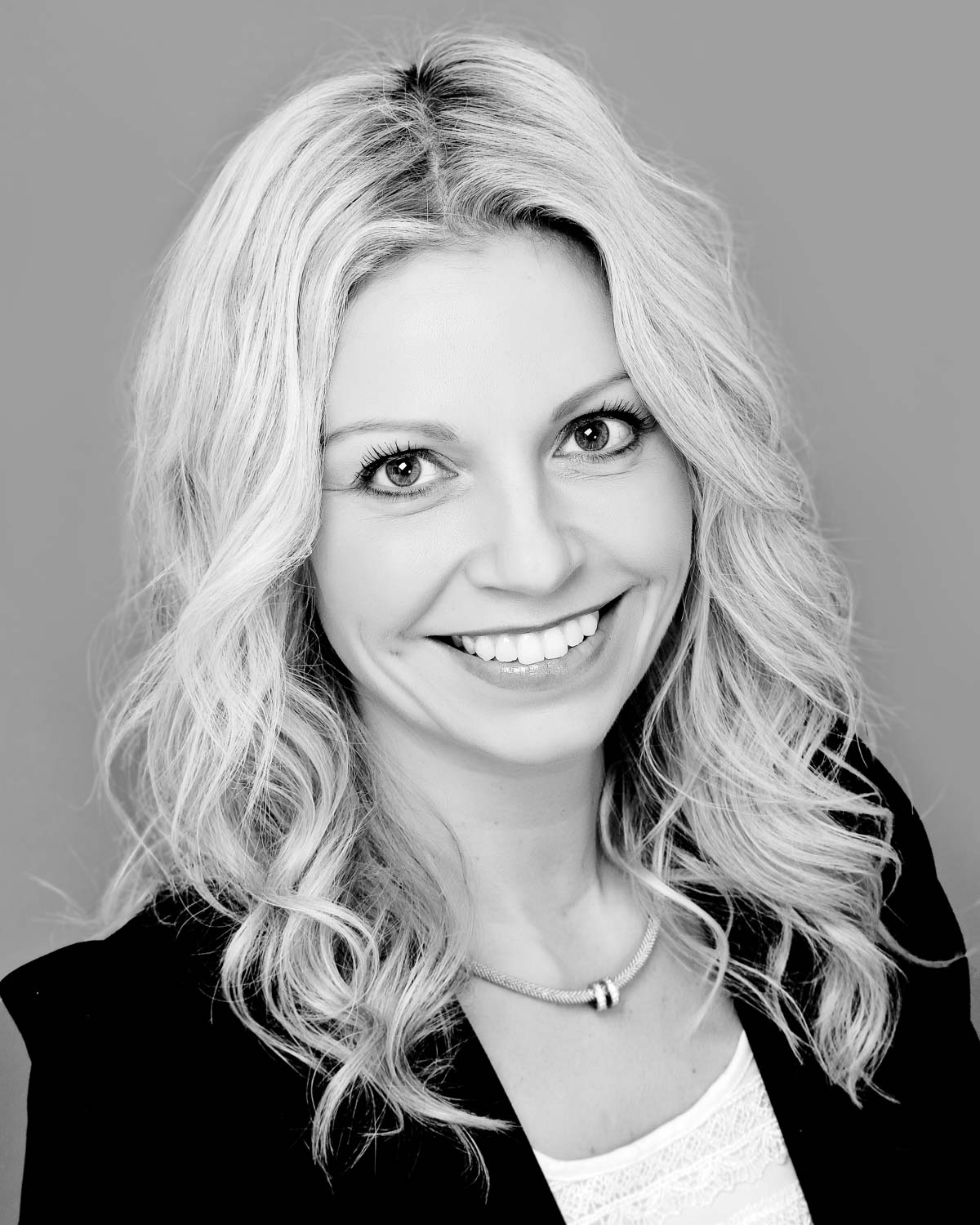 headshot of a business women for her linked in