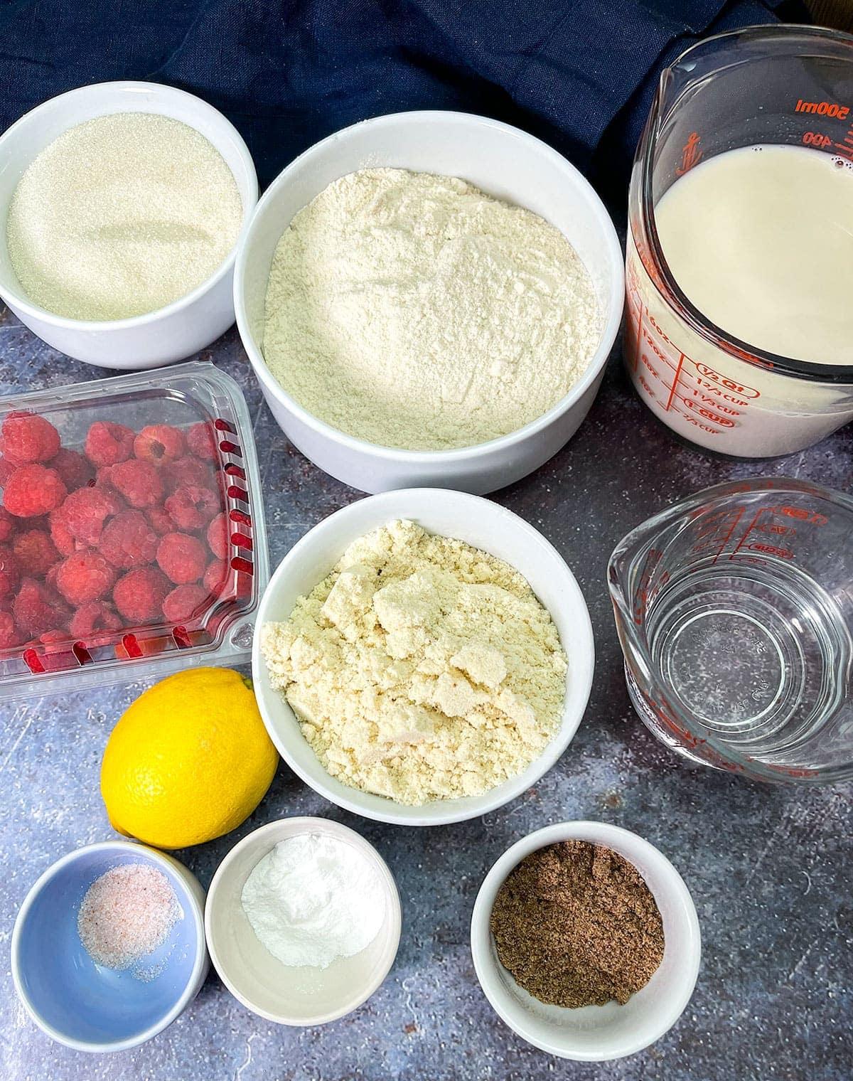 raspberry lemon cake ingredients on a grey background