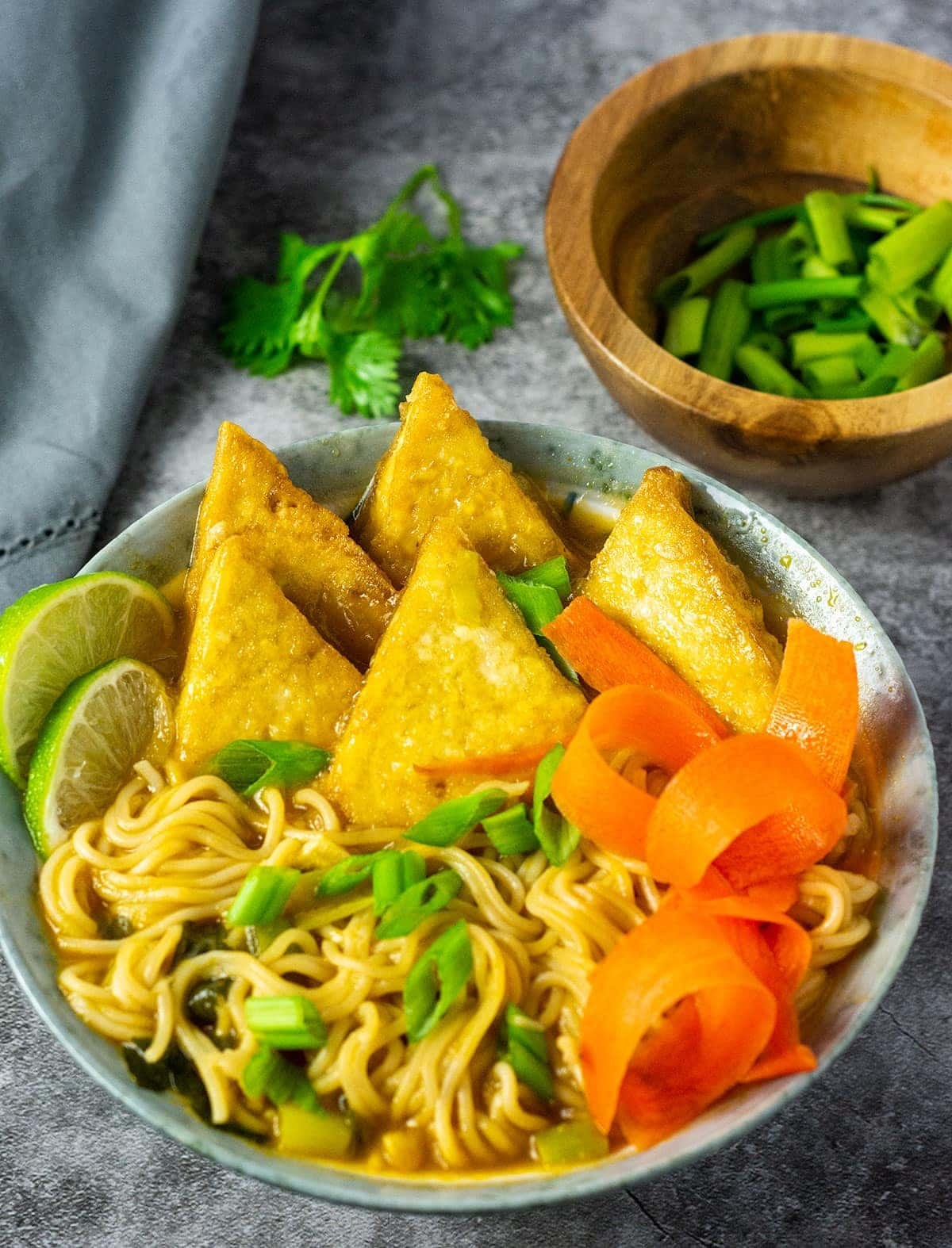 Close up image of vegan ramen soup in a bowl with fried tofu