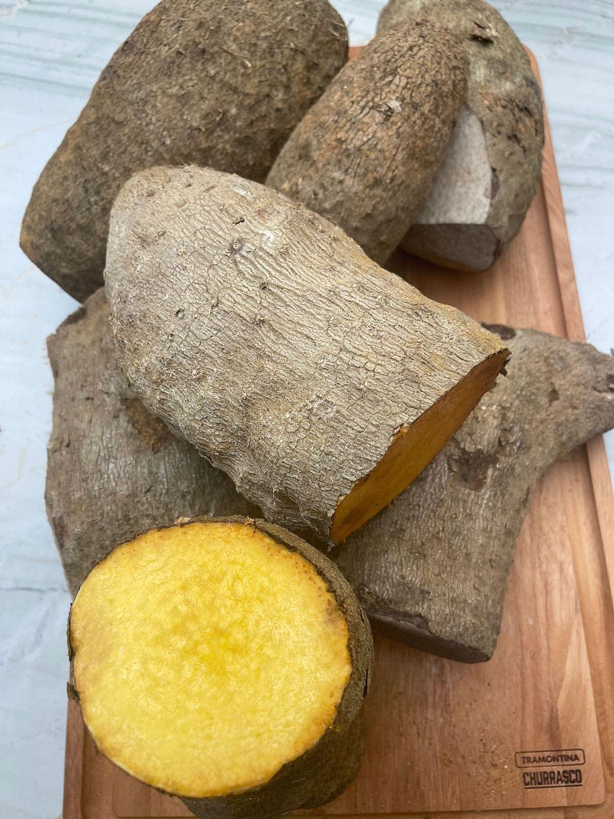 yellow yam tubers on a cutting board