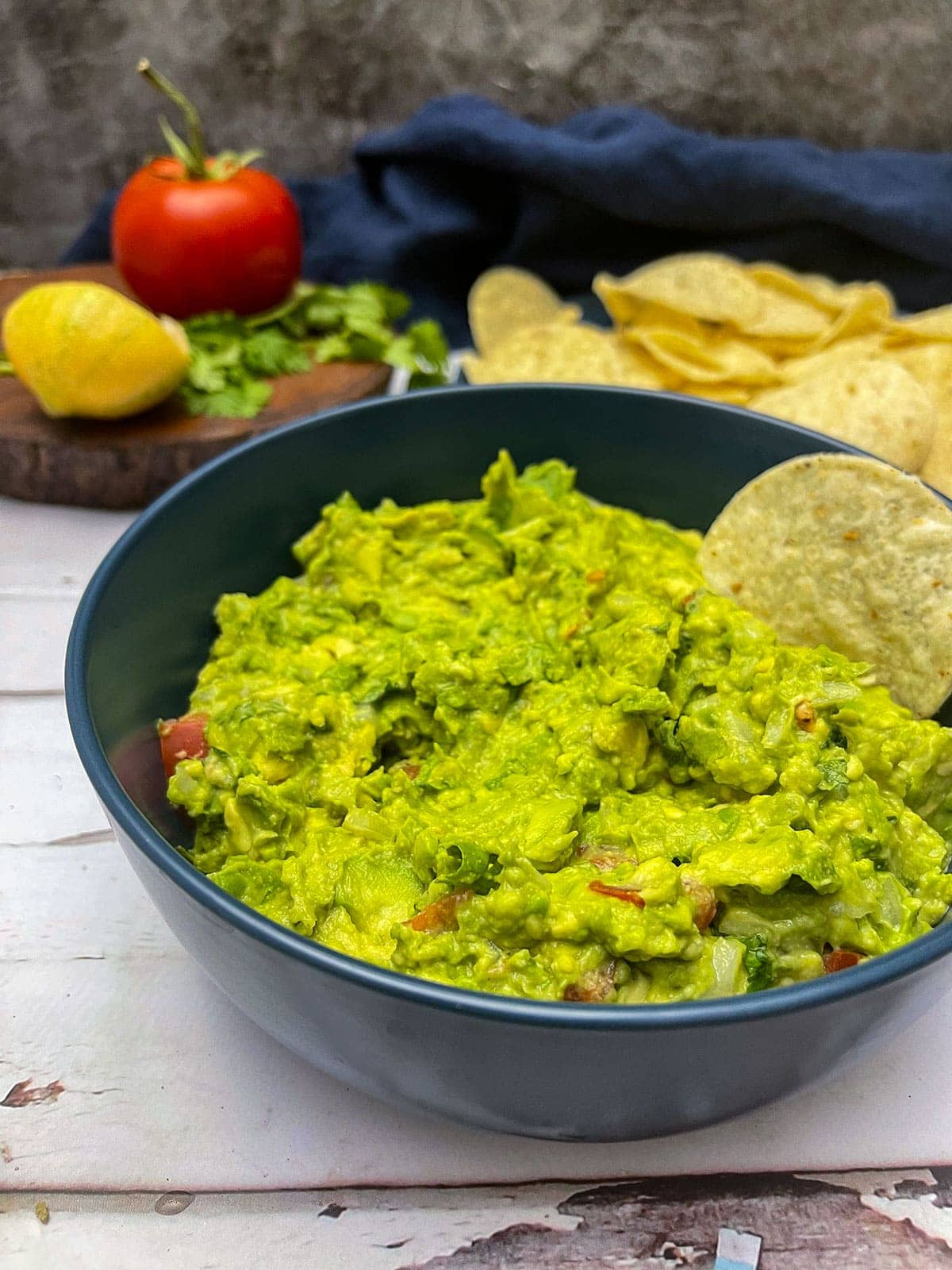 guacamole in a blue bowl with chips