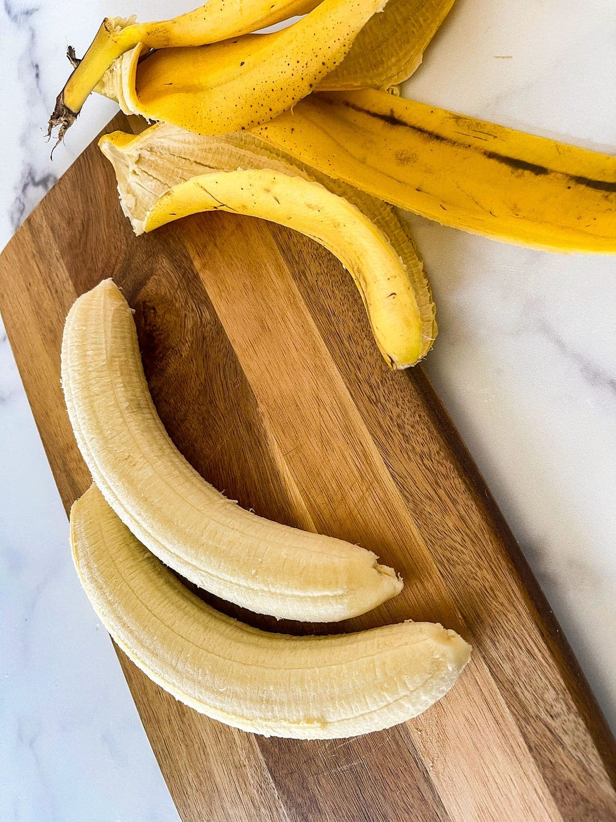 peeling bananas for banana ice cream