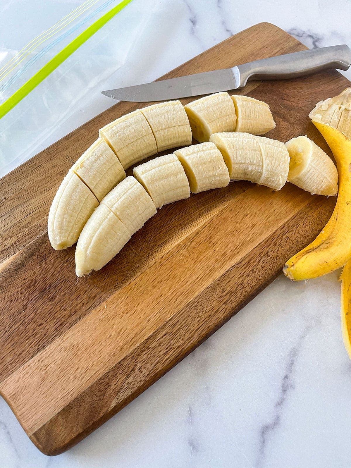 Peel bananas cut into slices on a wooden cutting board