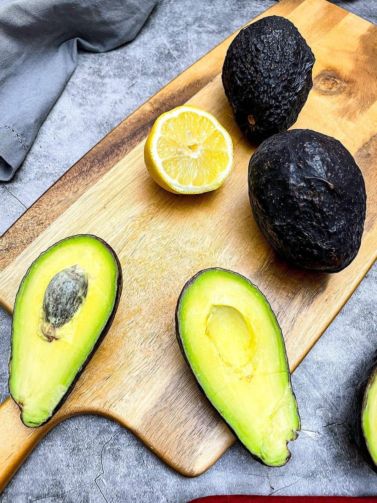 how to freeze avocado in halves on a cutting board with lemon