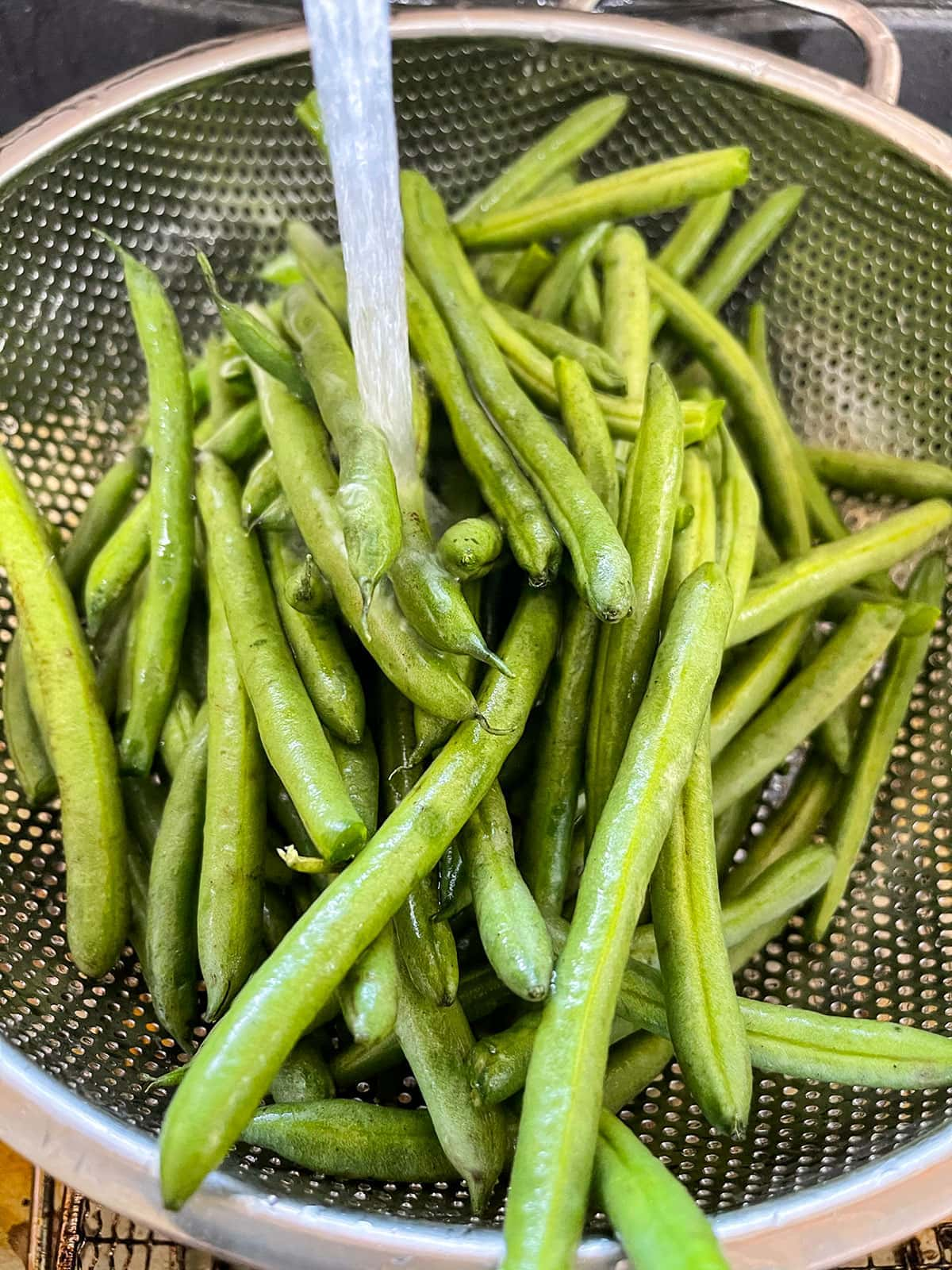green beans being washed