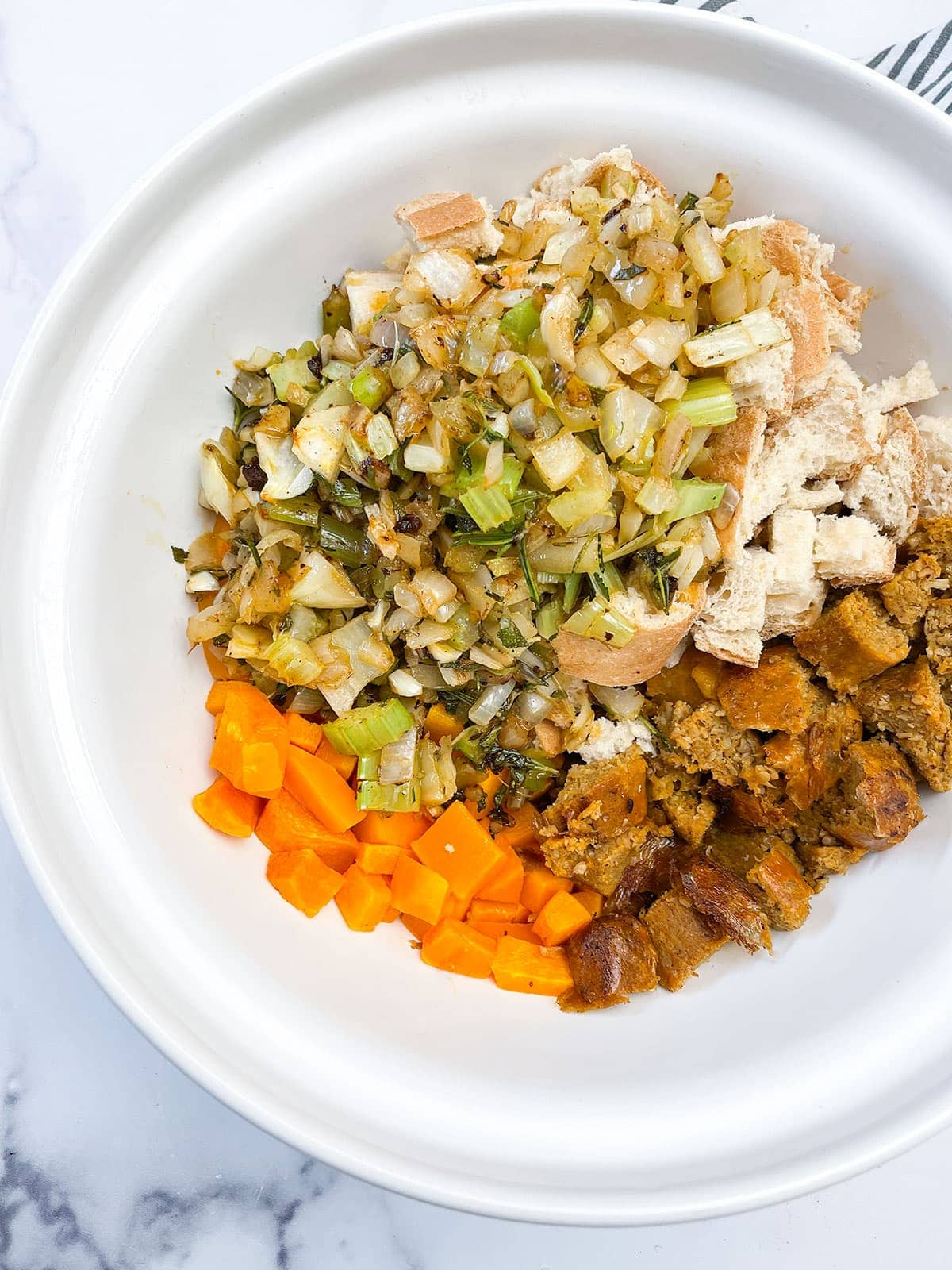 butternut squash stuffing in a white bowl on a white background