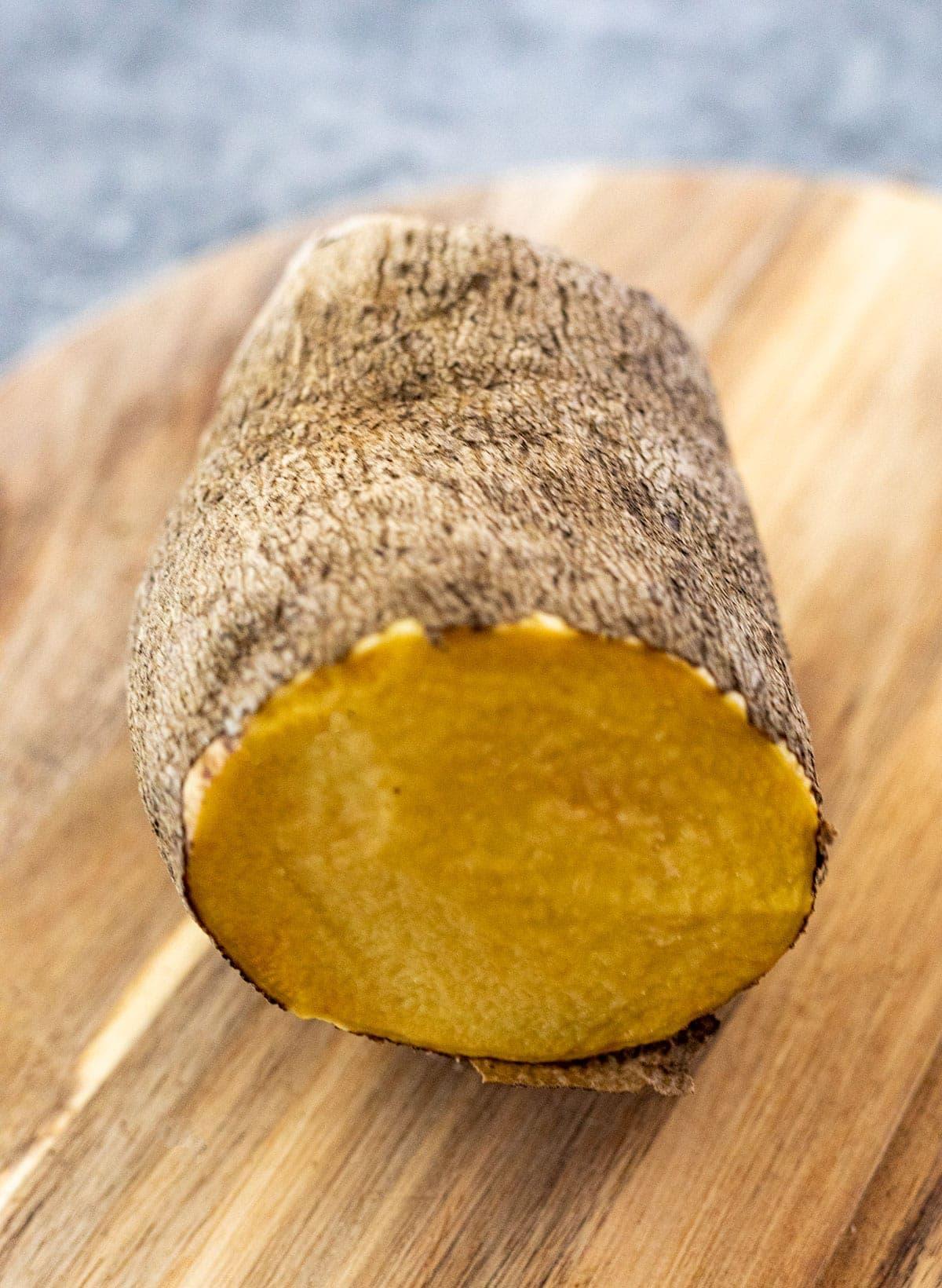 yellow yam whole on cutting board