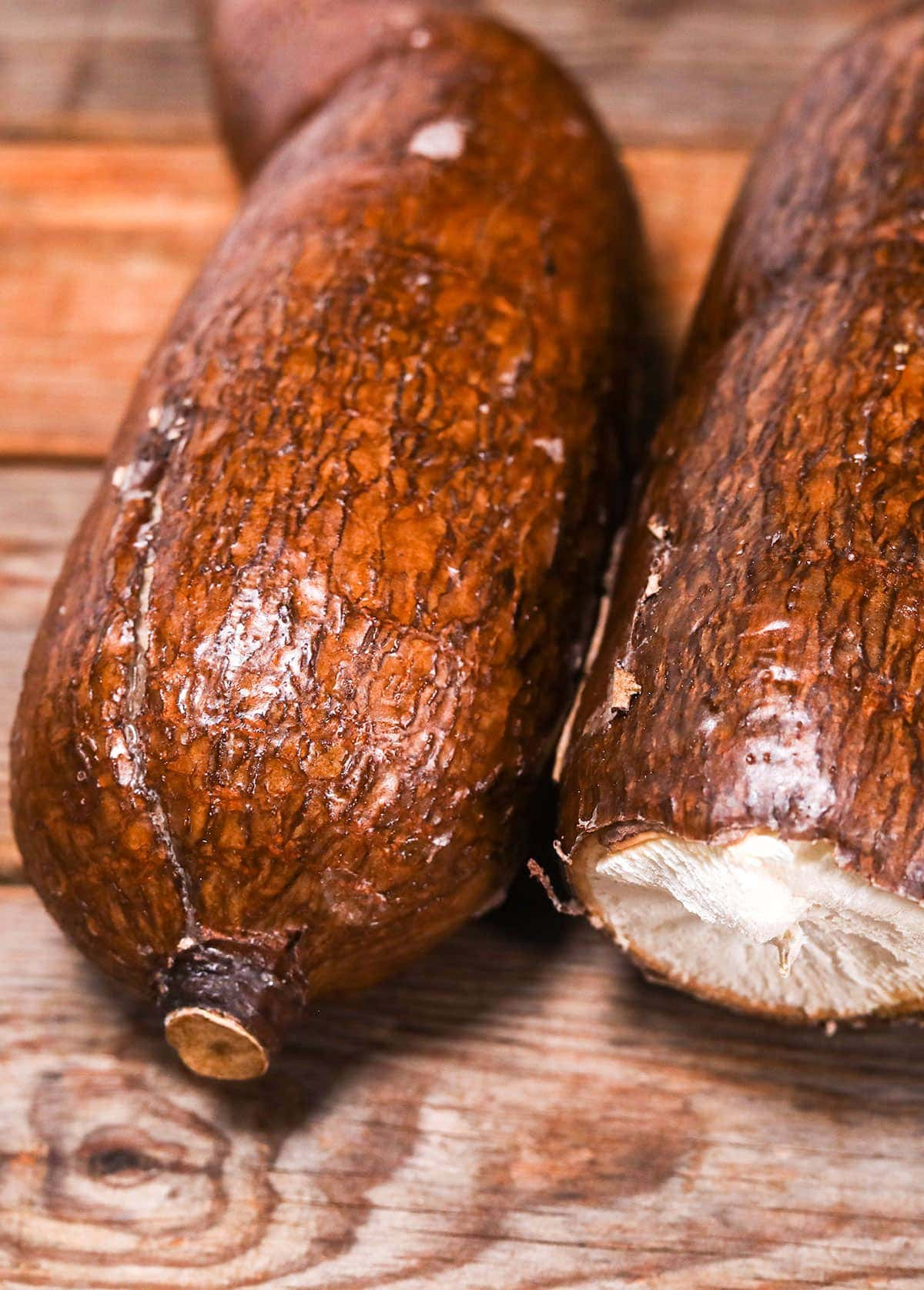 2 cassava tubers on a wooden background
