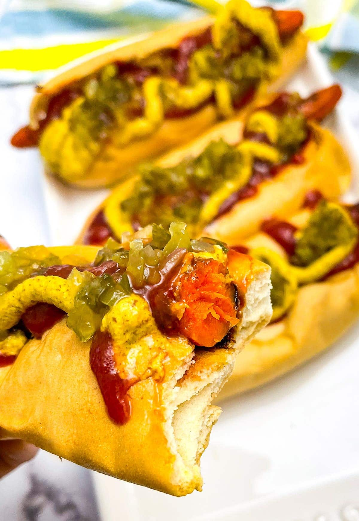 Carrot hotdogs with a bite taken