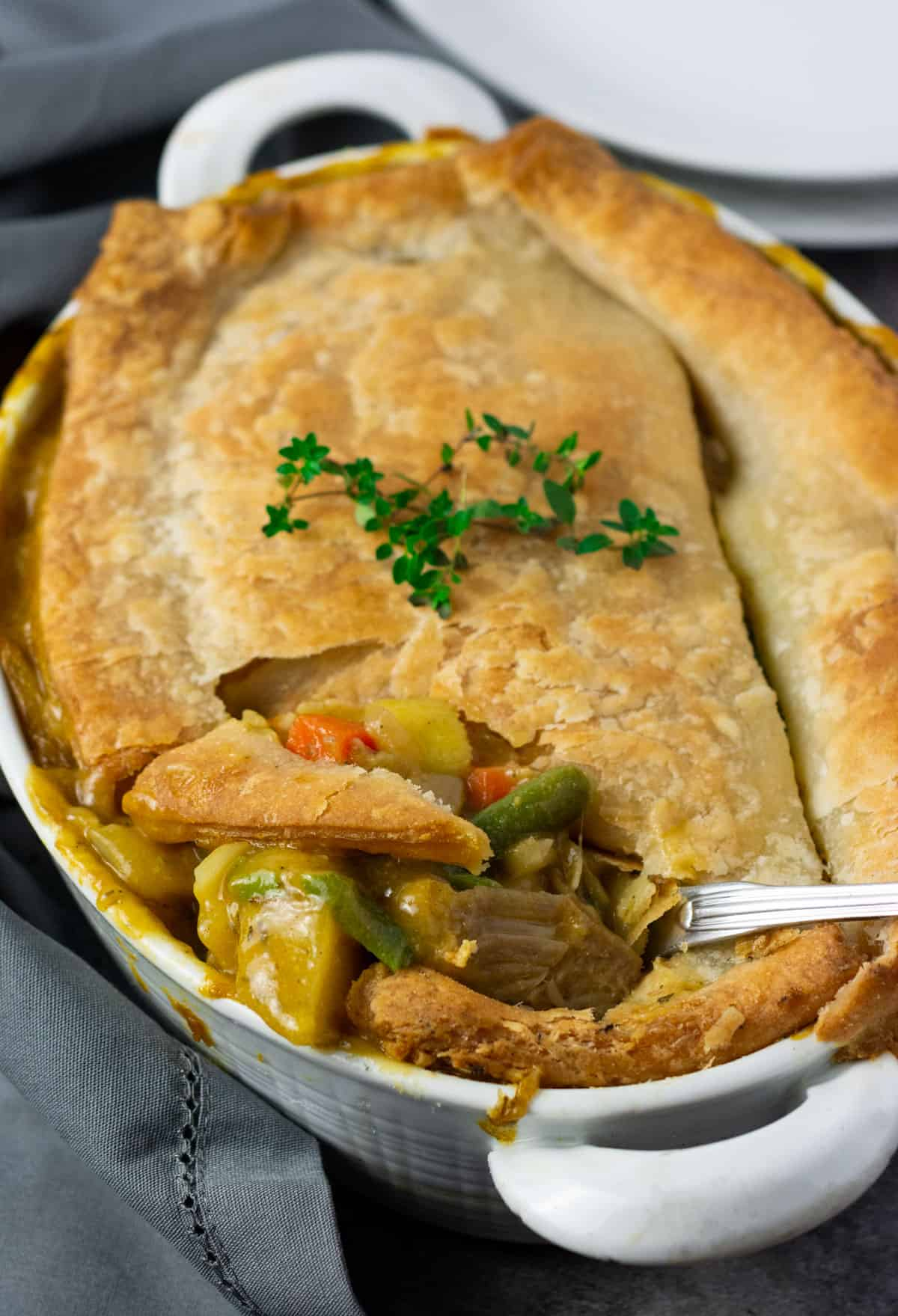 pot pie with a spoon taking out a piece