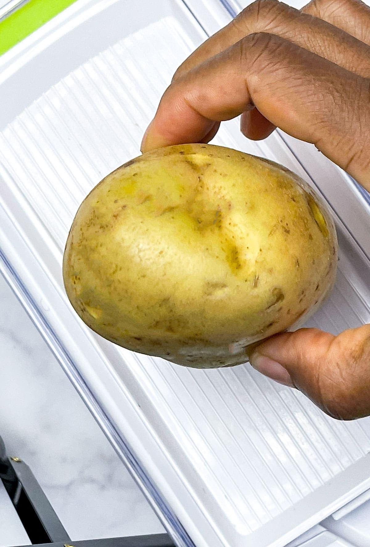 potato slices on the mandolin