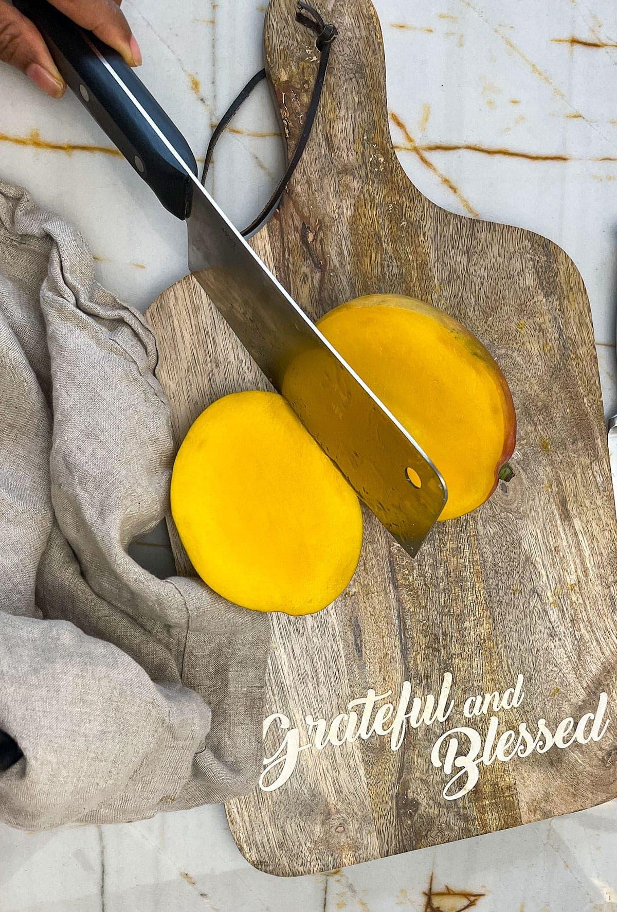 cutting mango on cutting board