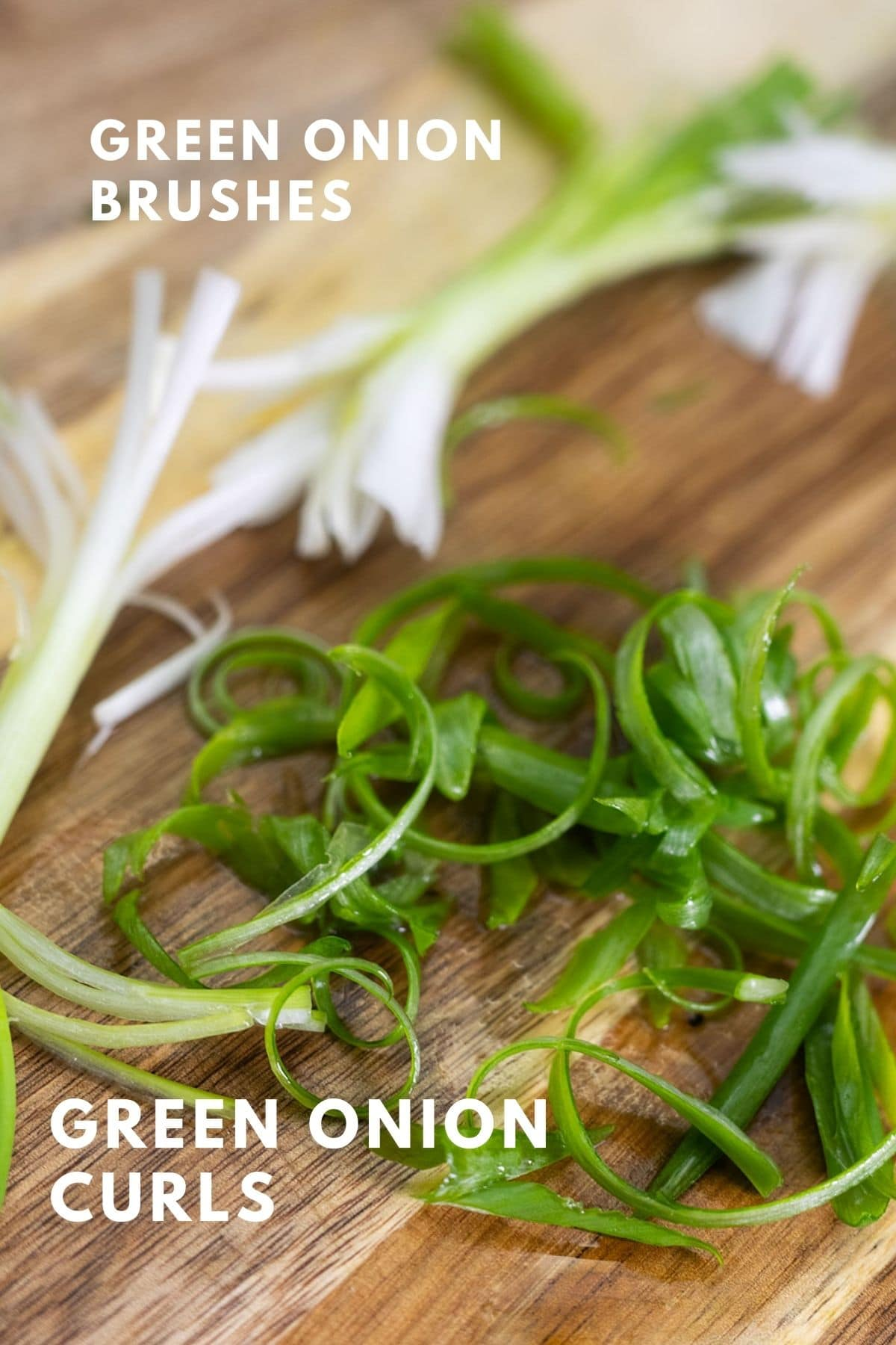 green onion brushes and curls on cutting board
