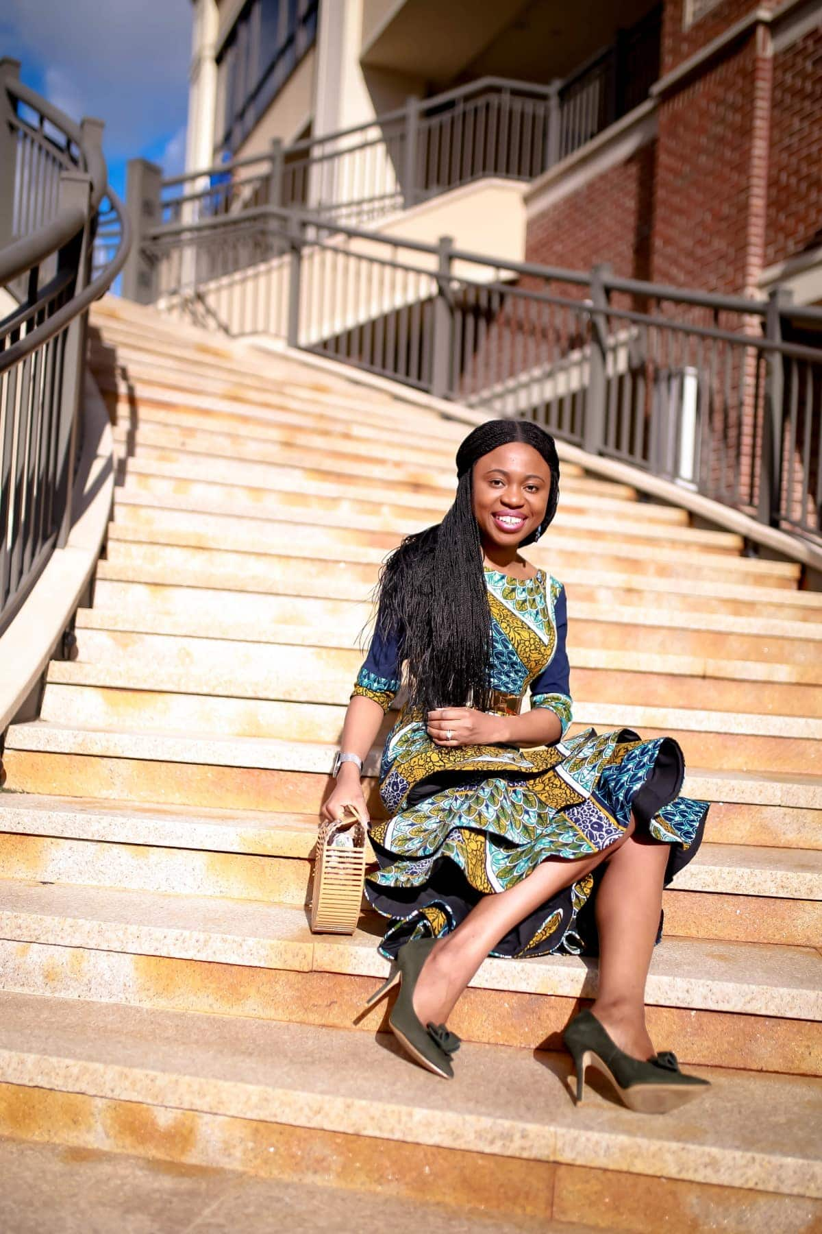 Looking for the perfect African print dress this summer? Ankara dress lover, Louisa, shares how she styles this lovely African attire, a three-tier ankara peplum dress in two ways. Plus details on where to buy the exact ankara midi dress she is wearing and how to make this African fashion dress for yourself. All about #africanfashionoutfits #africanprint #africanfashionstyles #nigerianfashion.