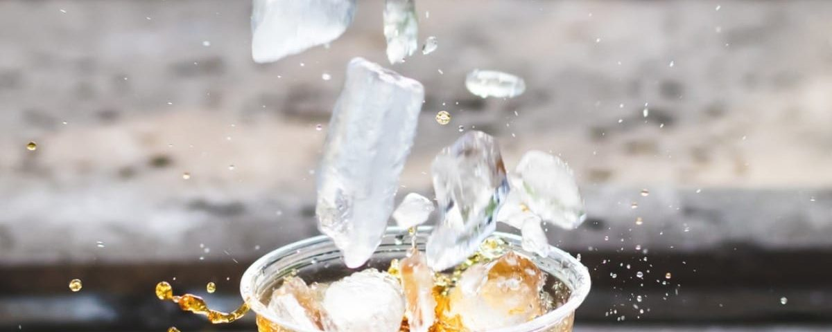 chewing ice from a drink