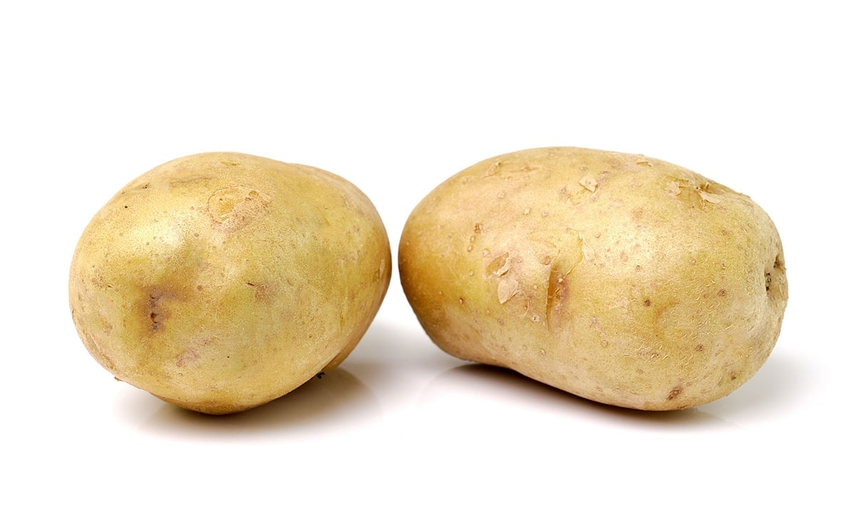 2 potatoes for homemade potato chips on a white background