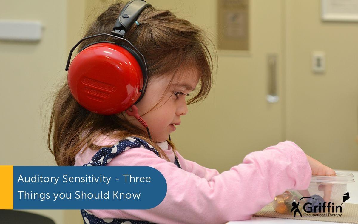 girl wearing headphones text auditory sensitivity
