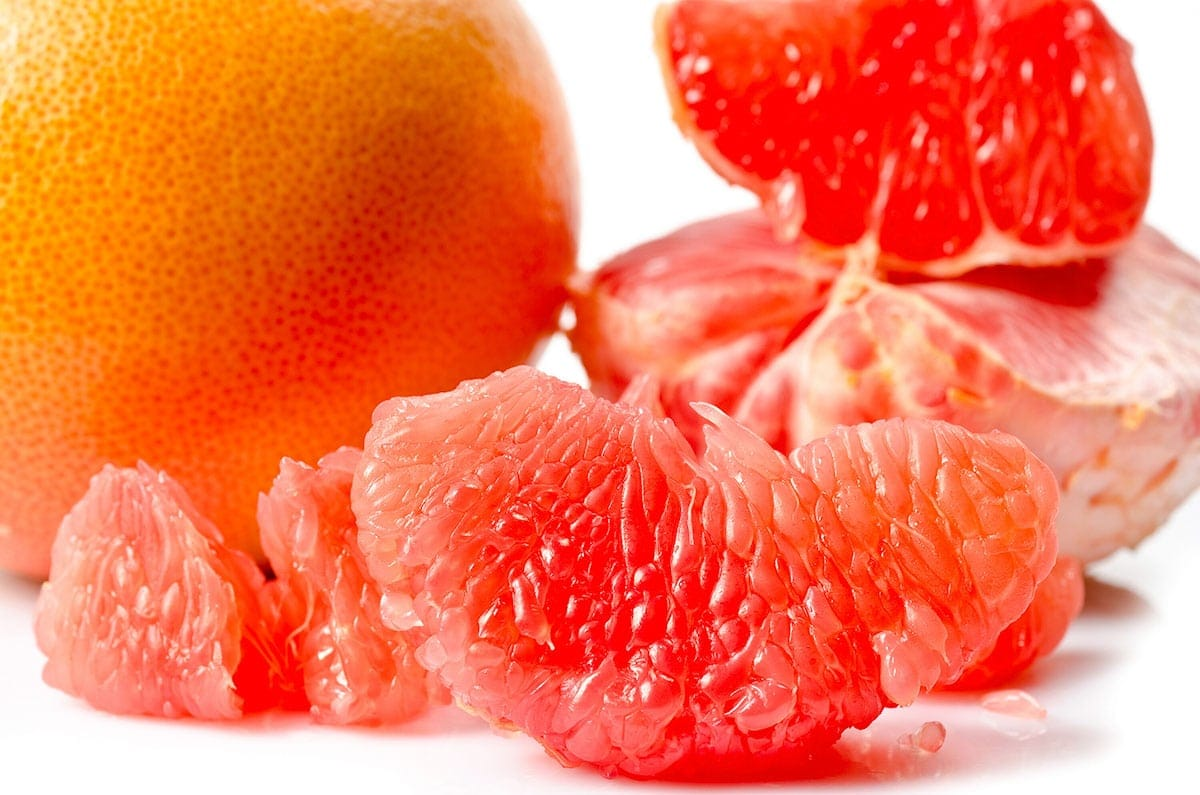 Grapefruit segments for grapefruit smoothie on a white background