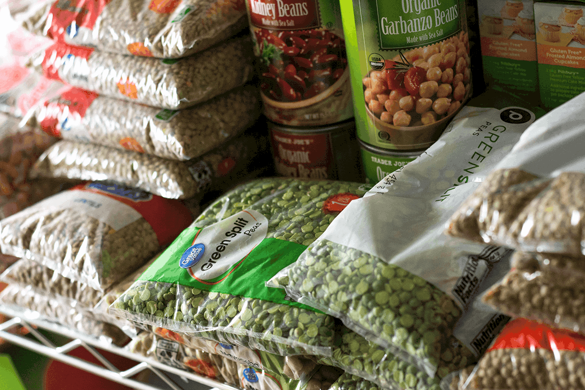 bags and cans of beans on shelf