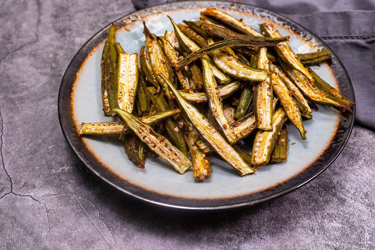 Okra fries on a green and brown plate