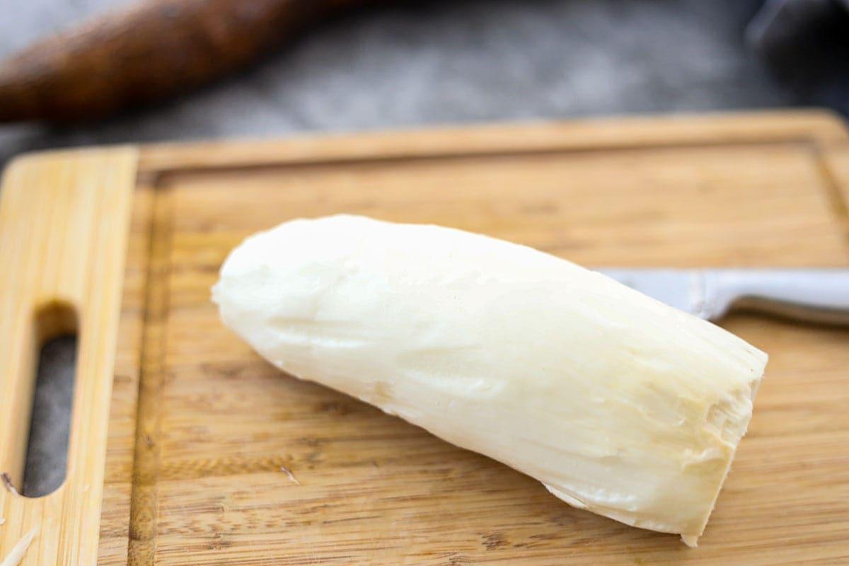 peeled cassava on cutting board