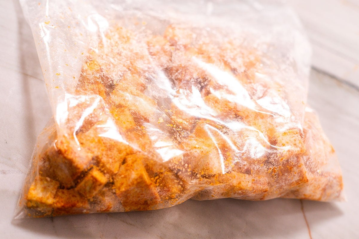 Tofu for sweet and sour tofu seasoned in a ziplock bag