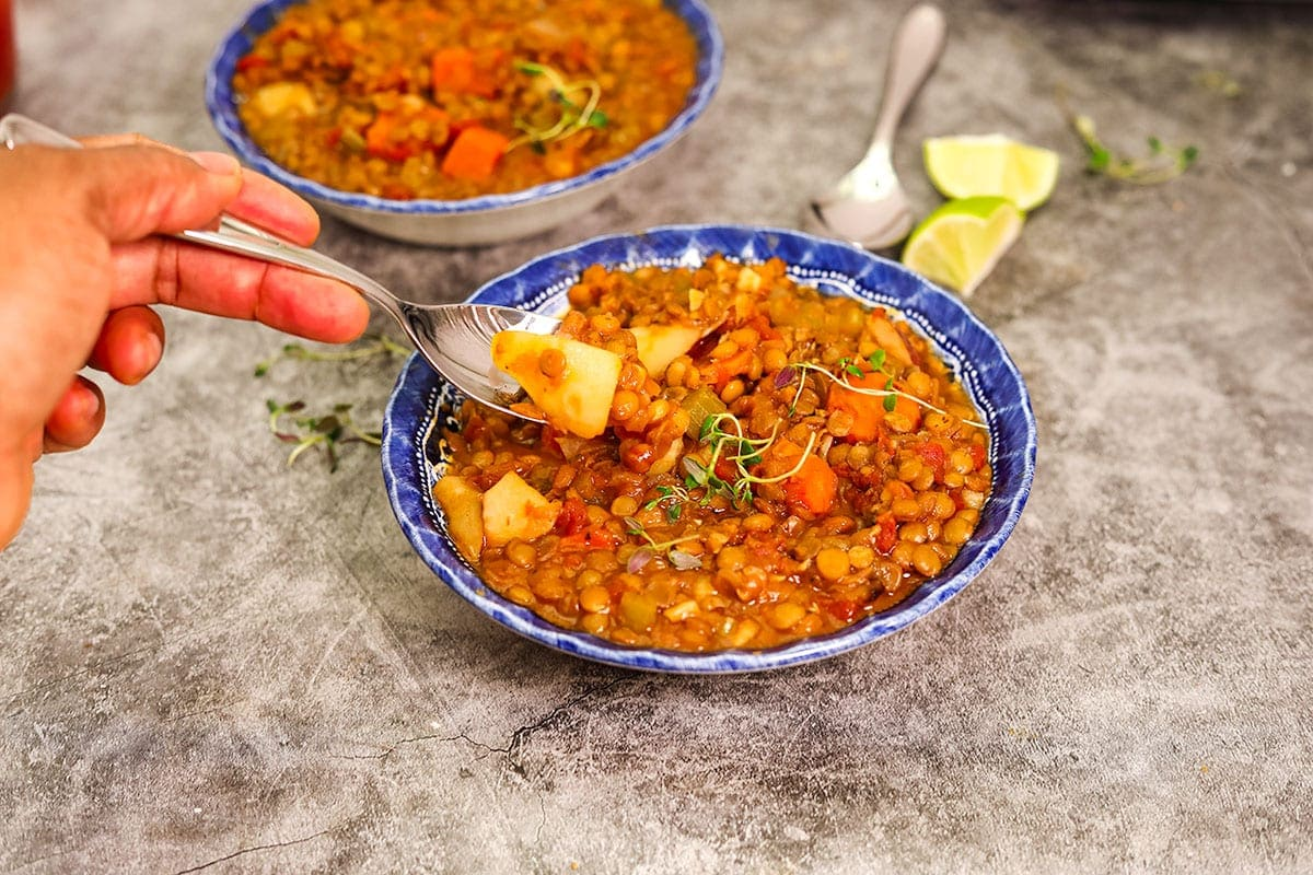 spoonful of lentil stew from bowl