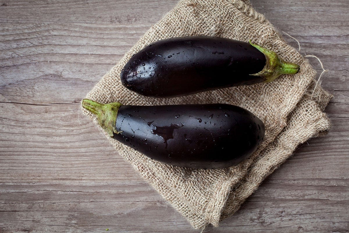two eggplants on a wooden background