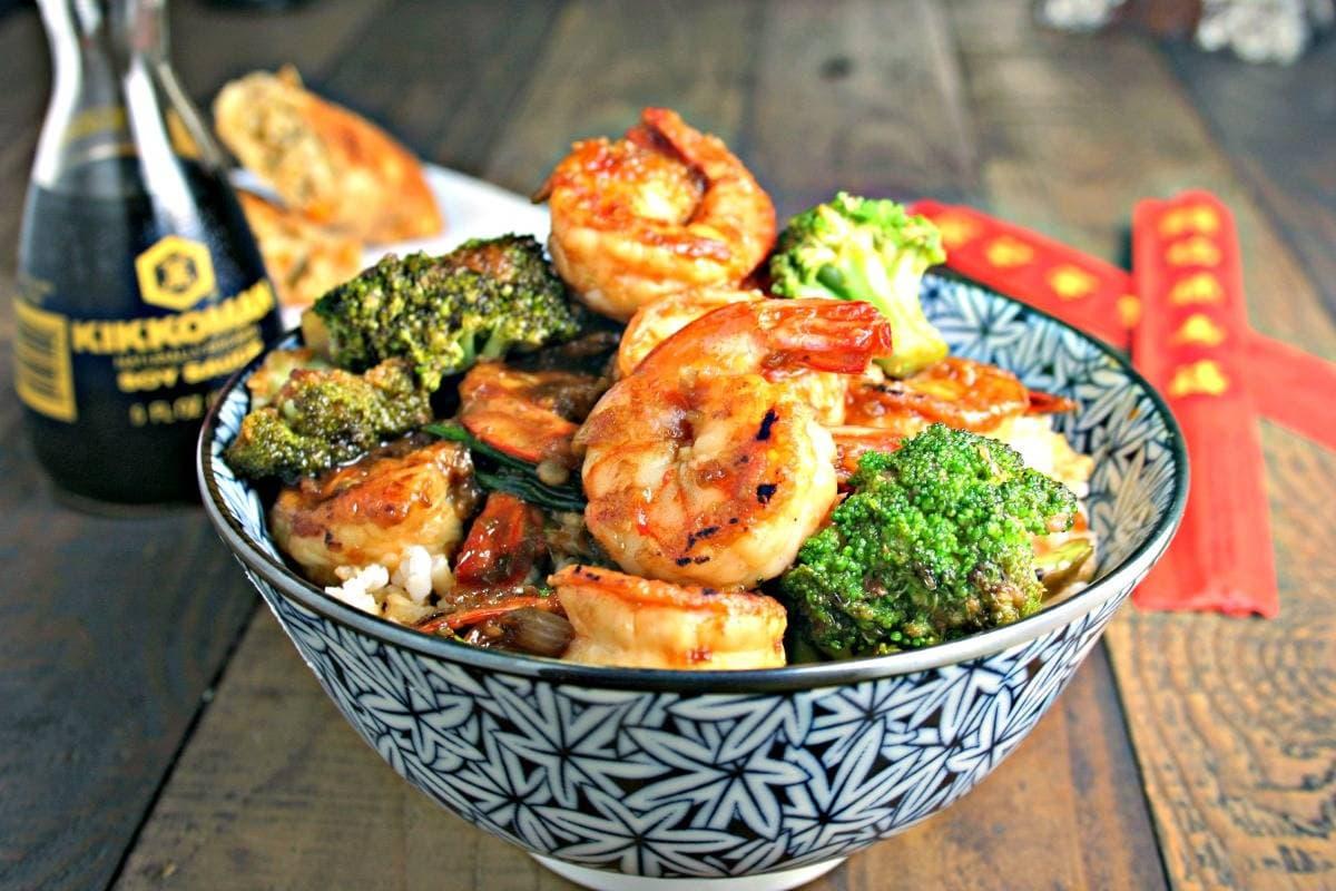 A bowl of food on a table, with Shrimp Broccoli Stir Fry