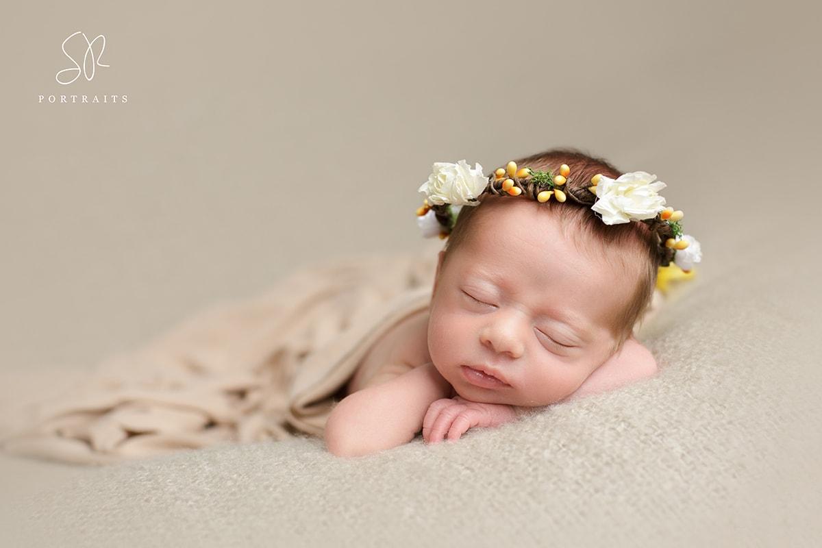 Baby girl on beige blanket. Newborn Photography Nottinghamshire