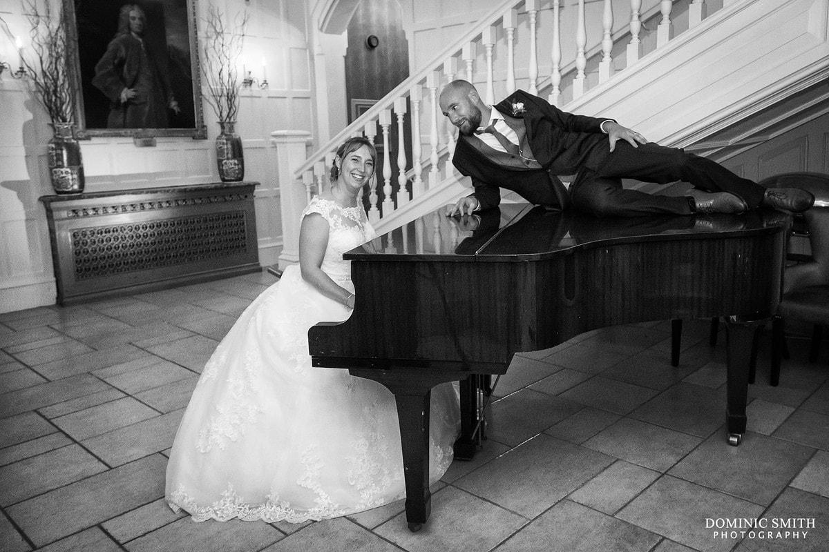 Bride Playing Piano at Alexander House