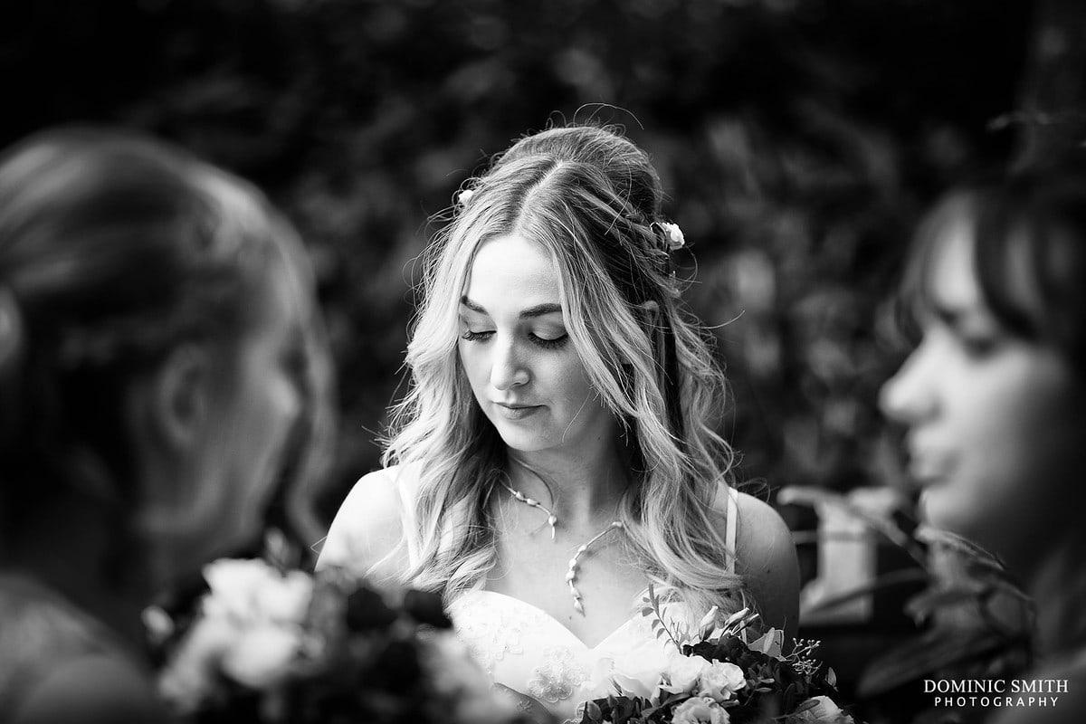 Bride waits at Nymans Gardens