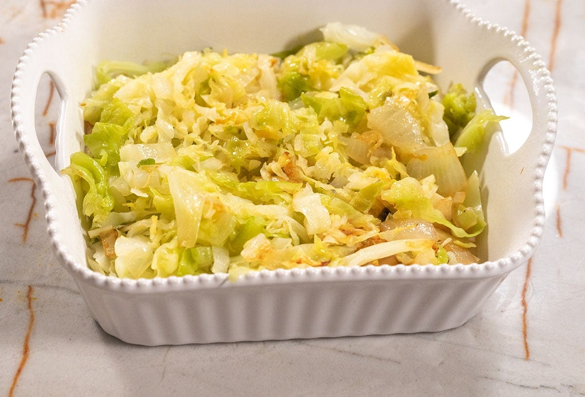 cabbage saute in a casserole pan