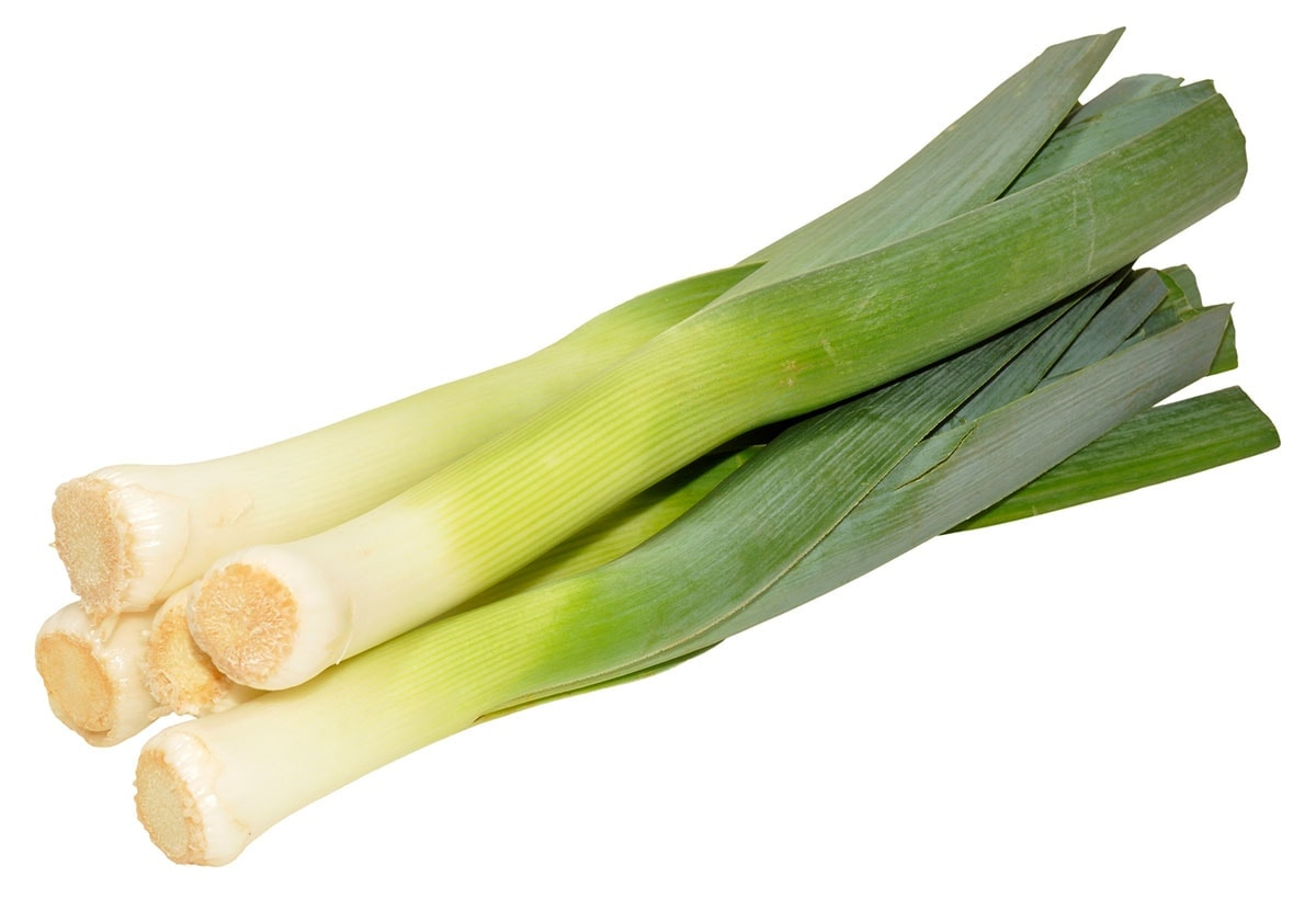 Trimmed leeks on a white background