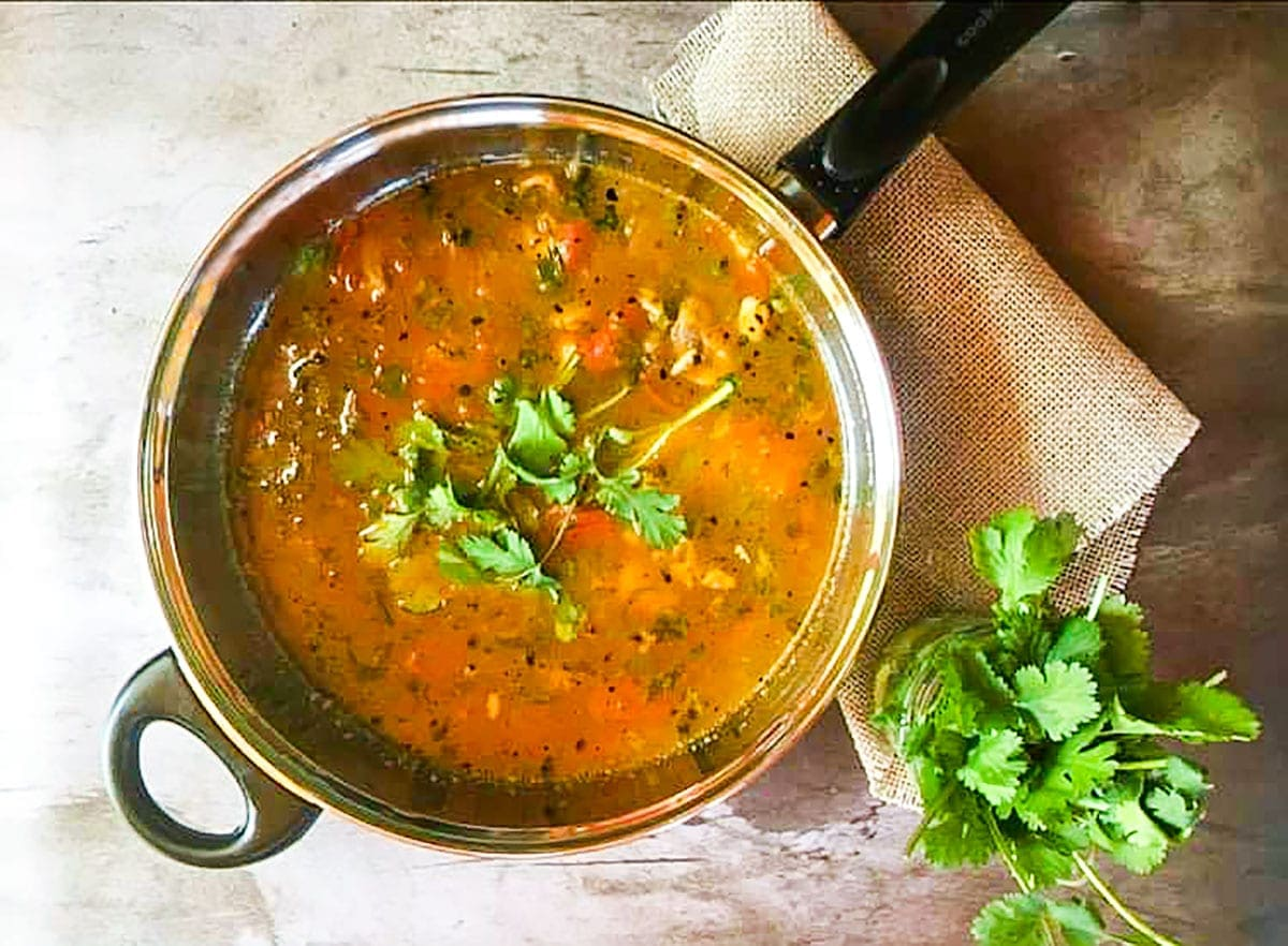 Cooking tomato rasam
