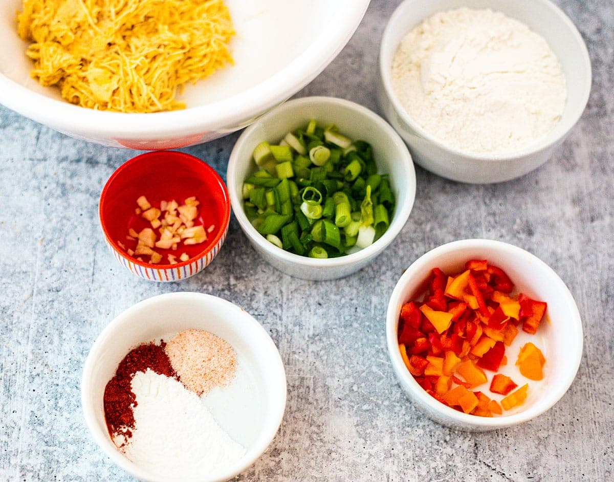 Ingredients for plantain fritters on a grey concrete board