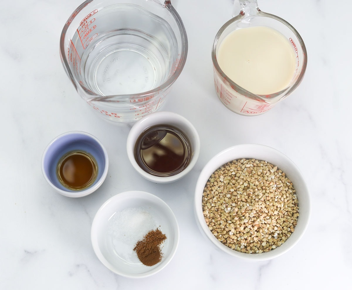 ingredients for buckwheat porridge in bowls on a white background