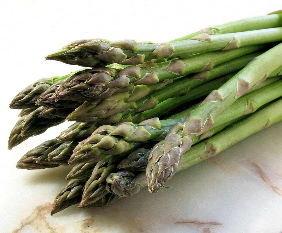 asparagus on a beige marbled background