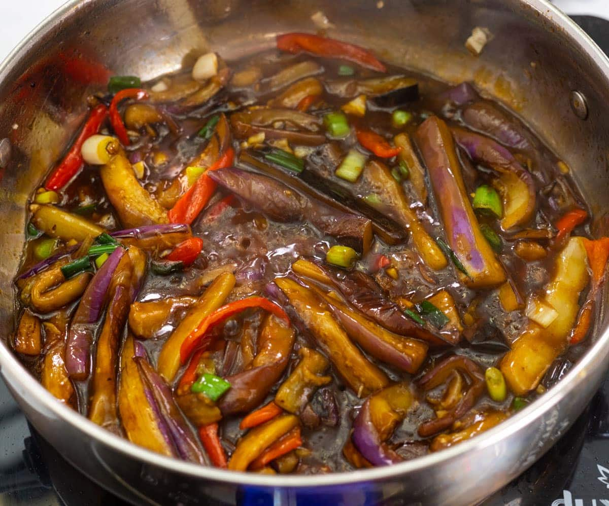 chinese eggplant in garlic sauce, in a silver saucepan