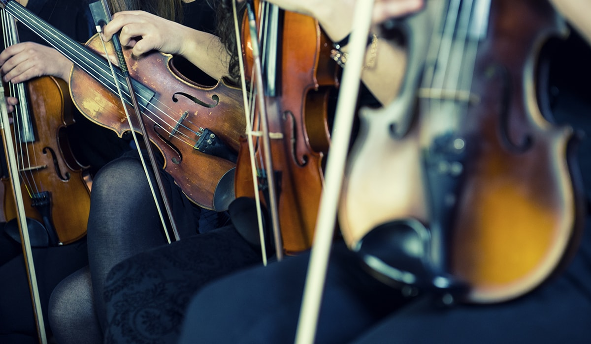 Female Violinists Preparing For Classical Concert
