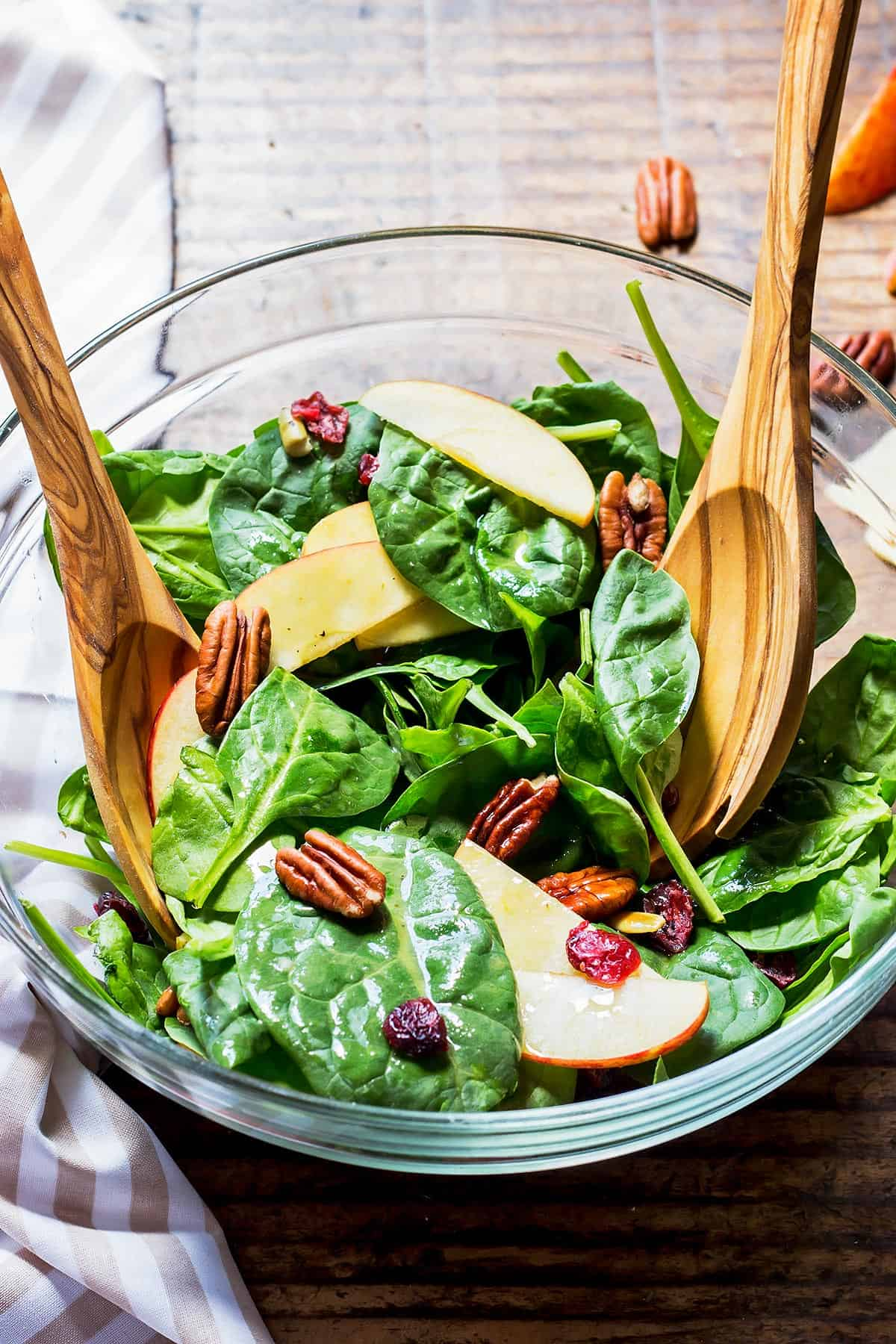 Spinach Salad with Wood Utensils
