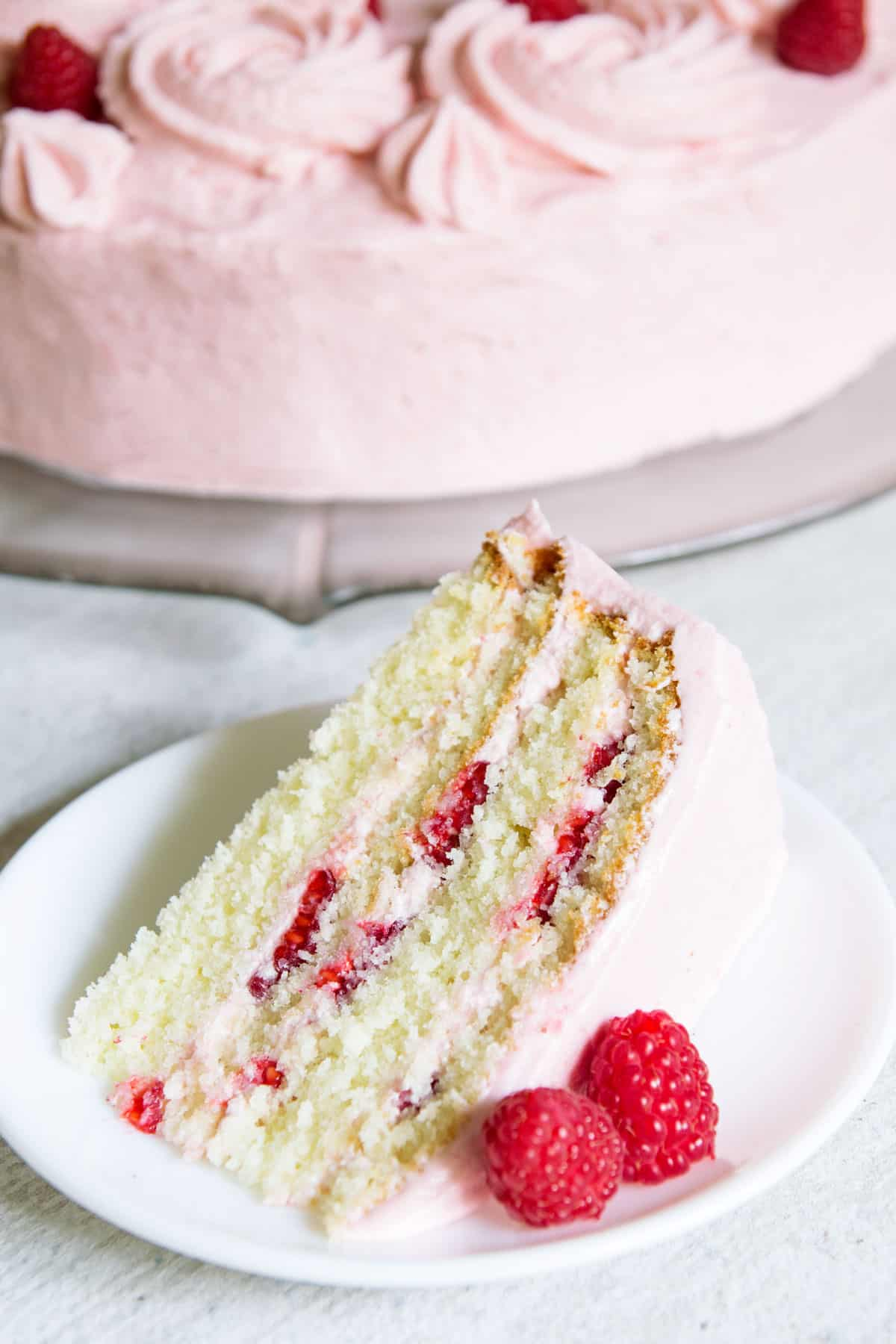 Slice of Raspberry Layer cake on a plate