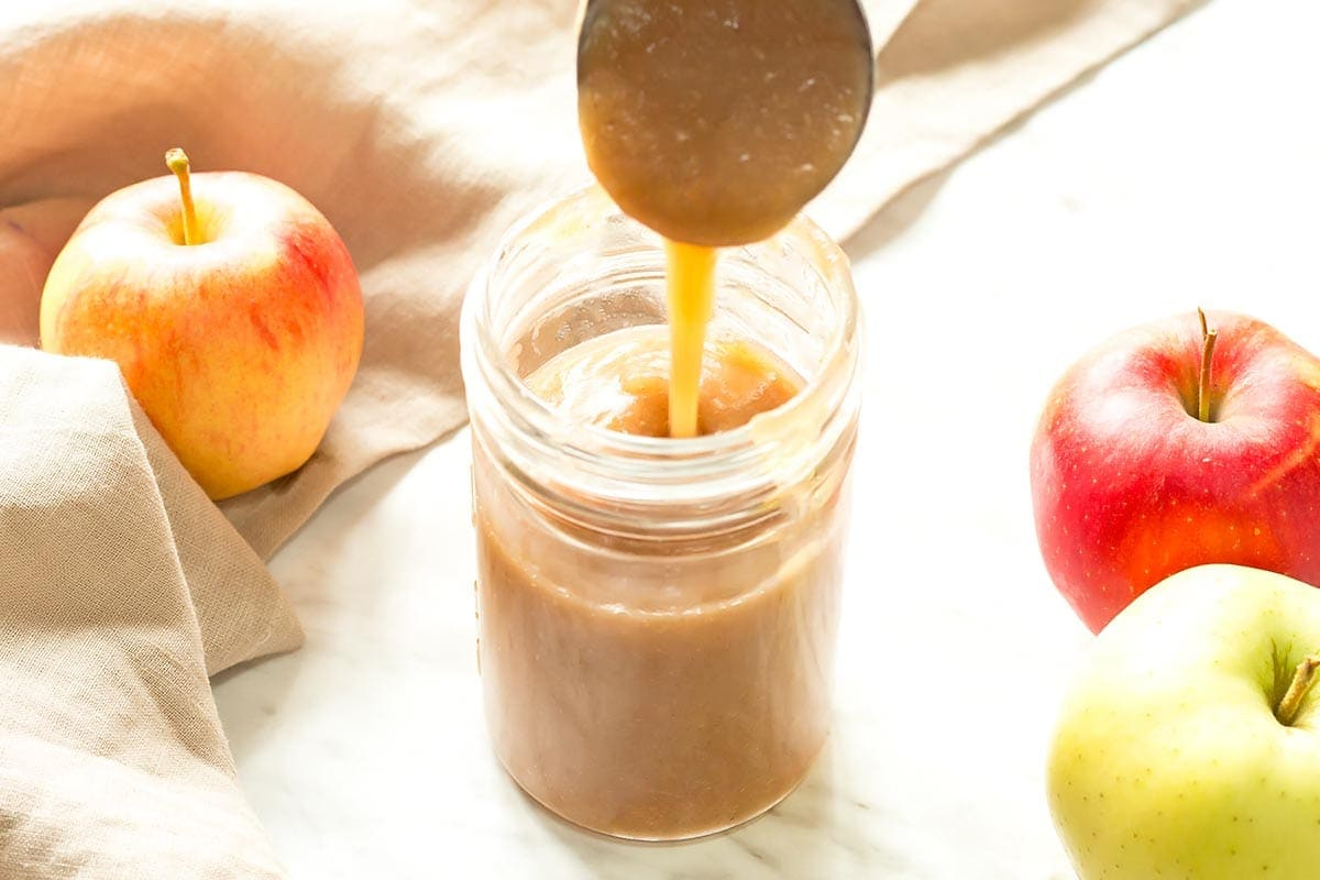 Filling Jar with Apple Sauce