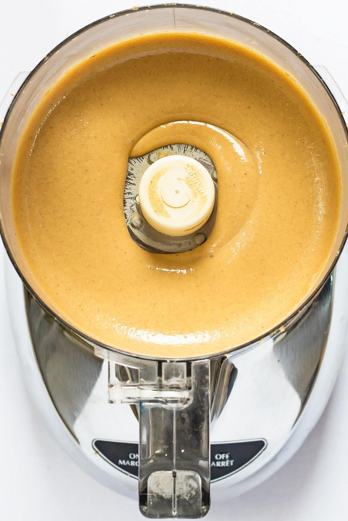 Finished homemade peanut butter in food processor bowl