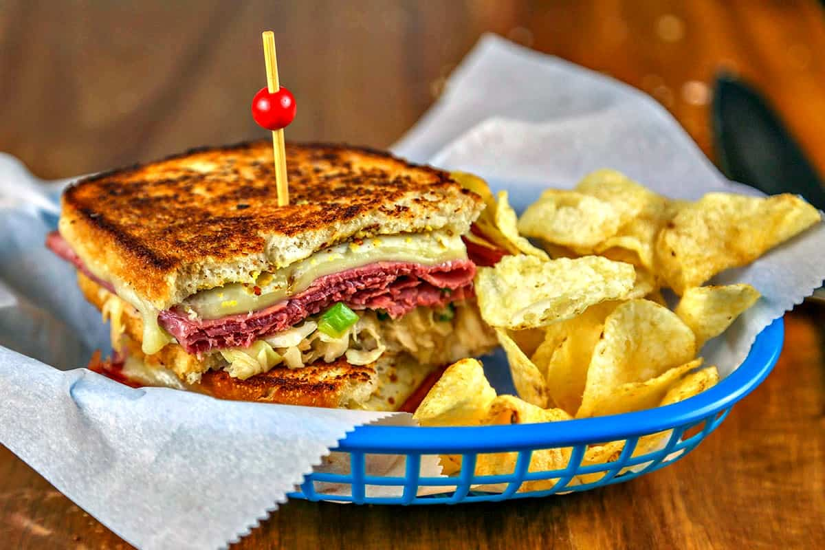 Super Coleslaw Reuben Sandwiches in basket with potato chips