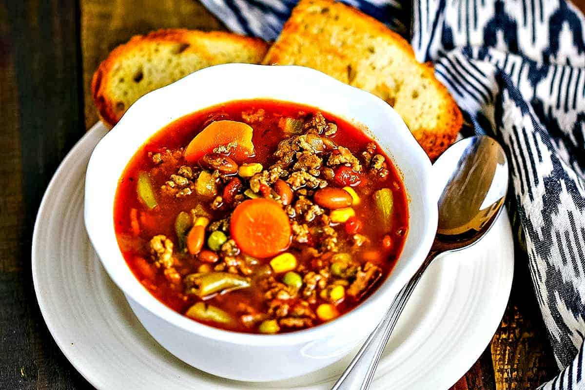 30-Minute Beefy Vegetable Soup in a white bowl with toasted bread