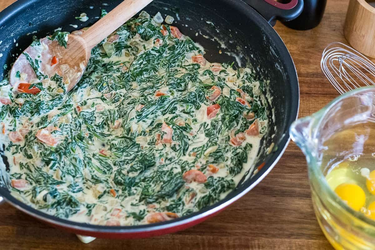 spinach and cheese in a skillet