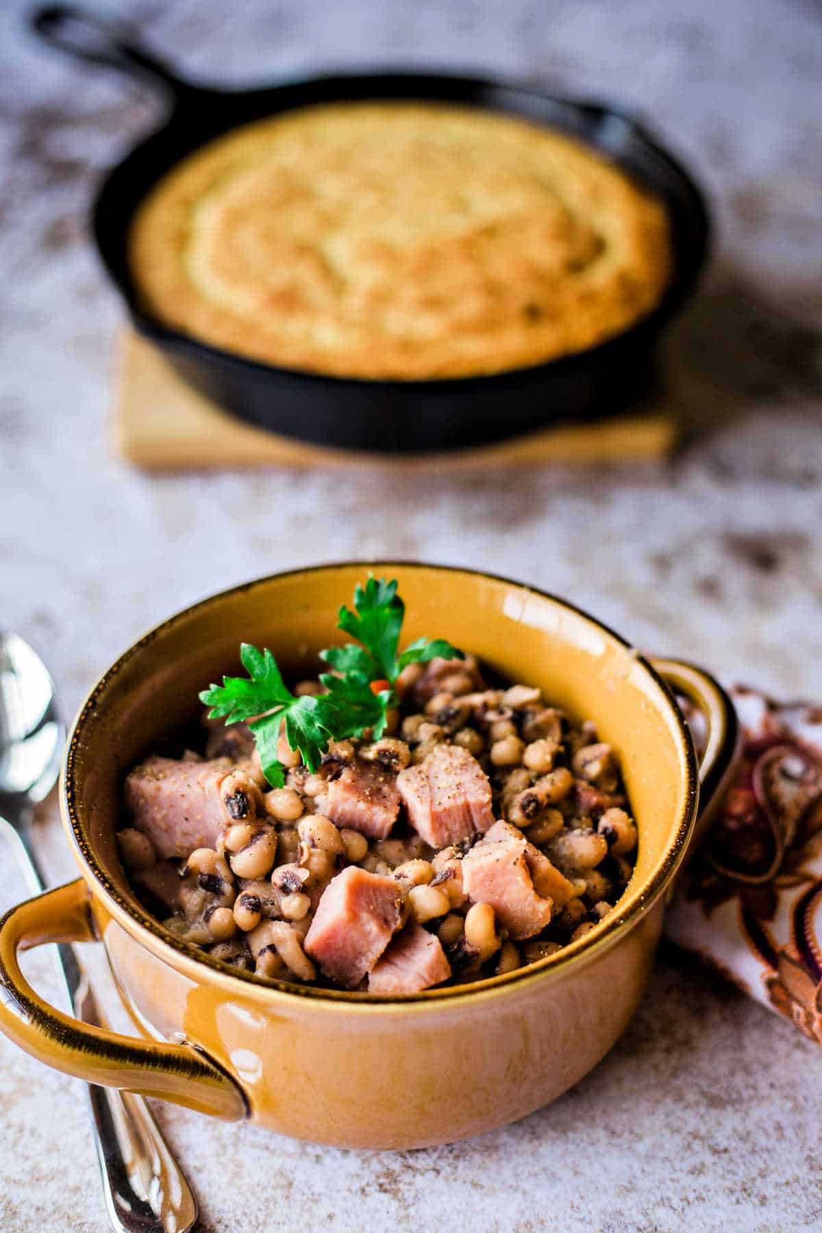 black eyed peas and a cast iron skillet of cornbread