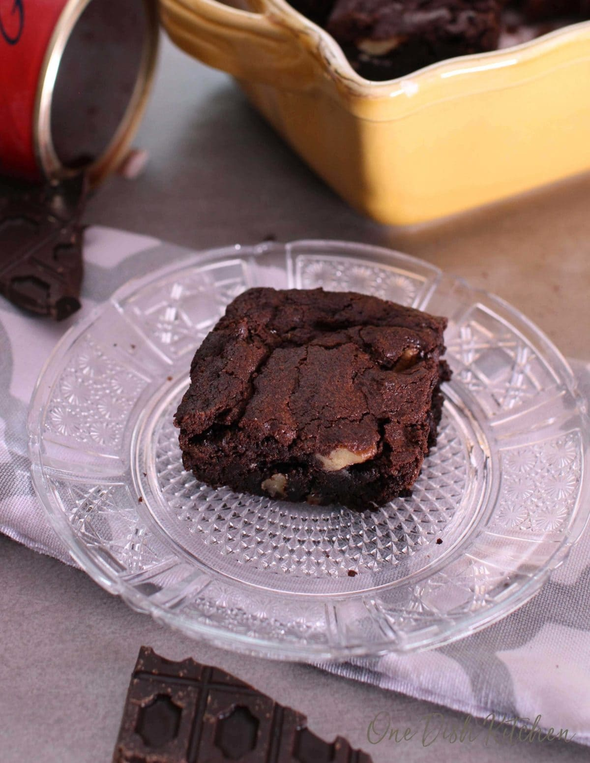 One brownie on a small plate.